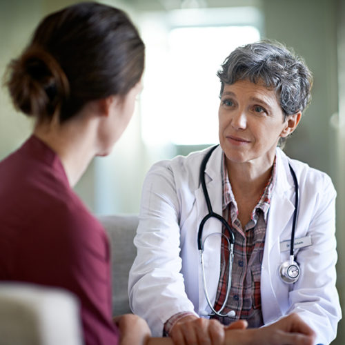 Photos of a doctor talking to a patient - M&N Insurance