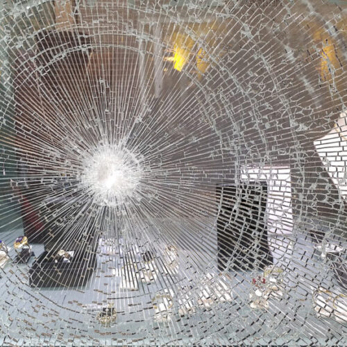 Photo of a smashed window - M&N Insurance